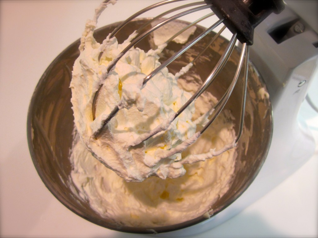 After beating cream cheese, confectionary sugar, salt and vanilla to a smooth and velvety texture,  we set  it aside. We whipped heavy cream until it began to hold firm peaks. (pictured here).