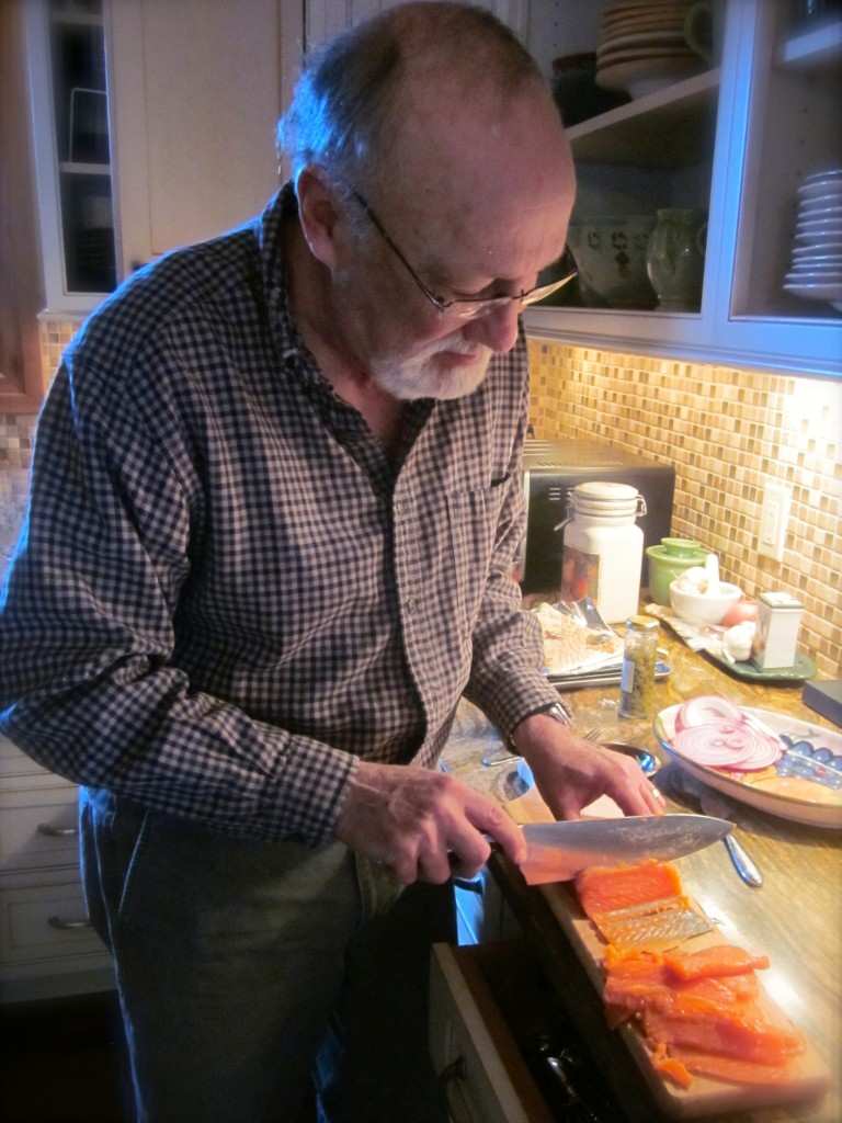 Bernie thinly slices the salmon, cutting on the diagonal, leaving the skin behind. (Please know that Donna and I are standing close behind giving Bernie directions!)