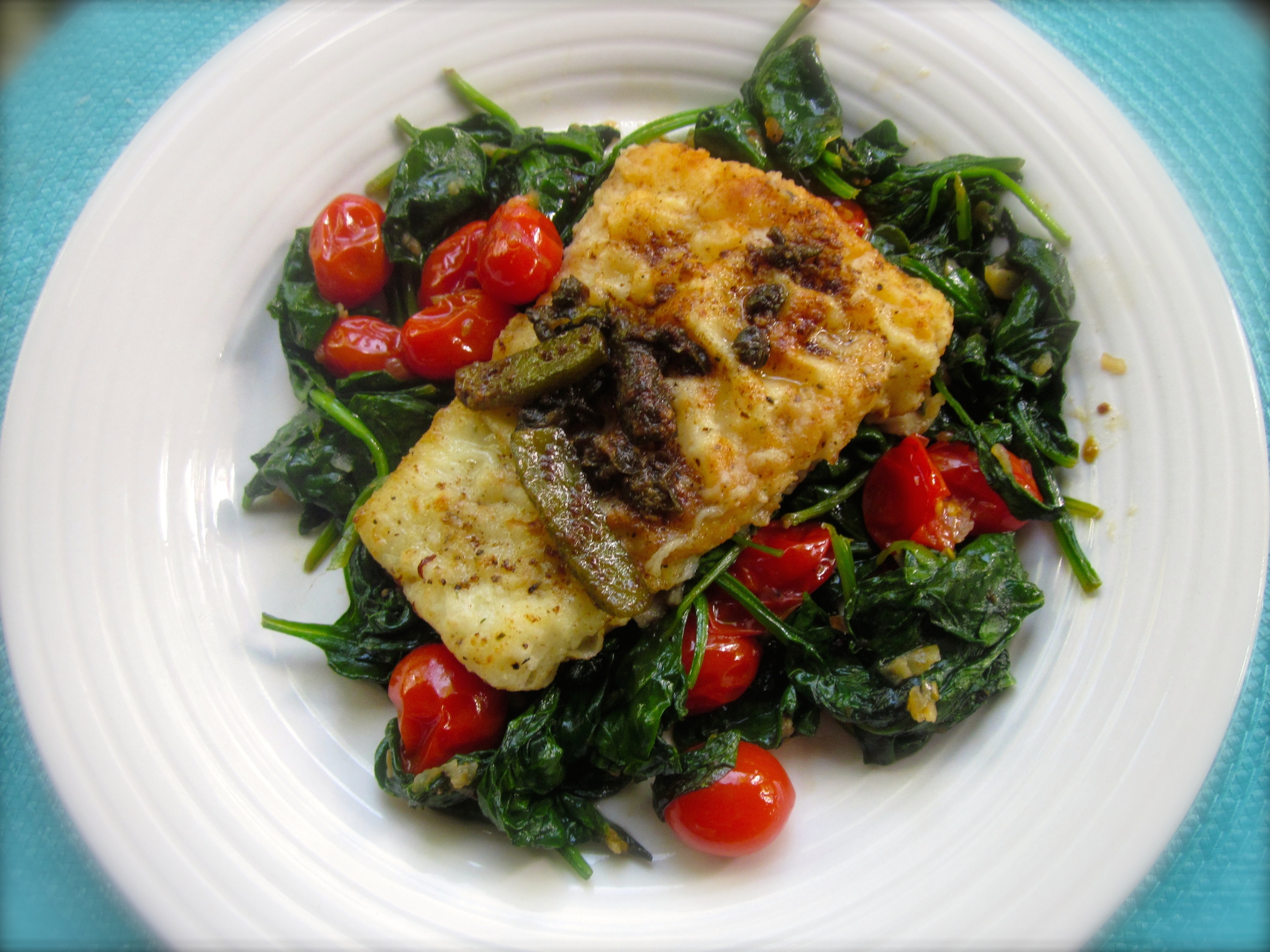 Wild Alaskan Pacific cod on a bed of Sauteed Spinach and tomatoes......totally, totally.