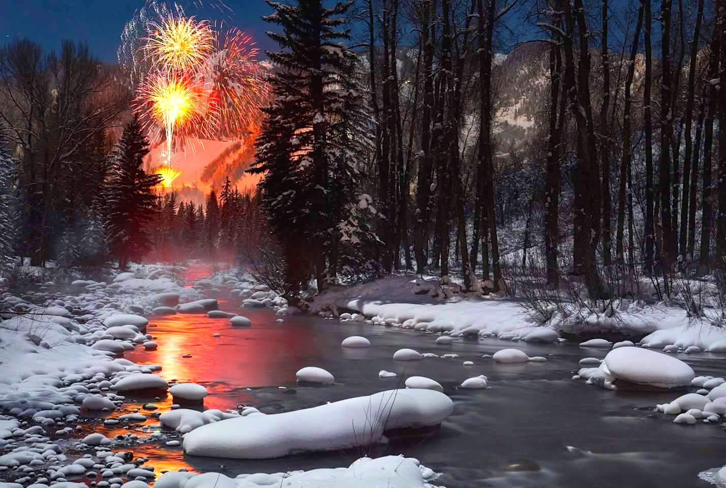Fireworks in Aspen as seen from the Roaring Fork River, New Years Eve, 2014. Photograph by Jeremy Swanson