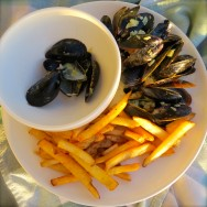 Curried mussels, french fries with a crusty baguette makes for a delicious dinner.