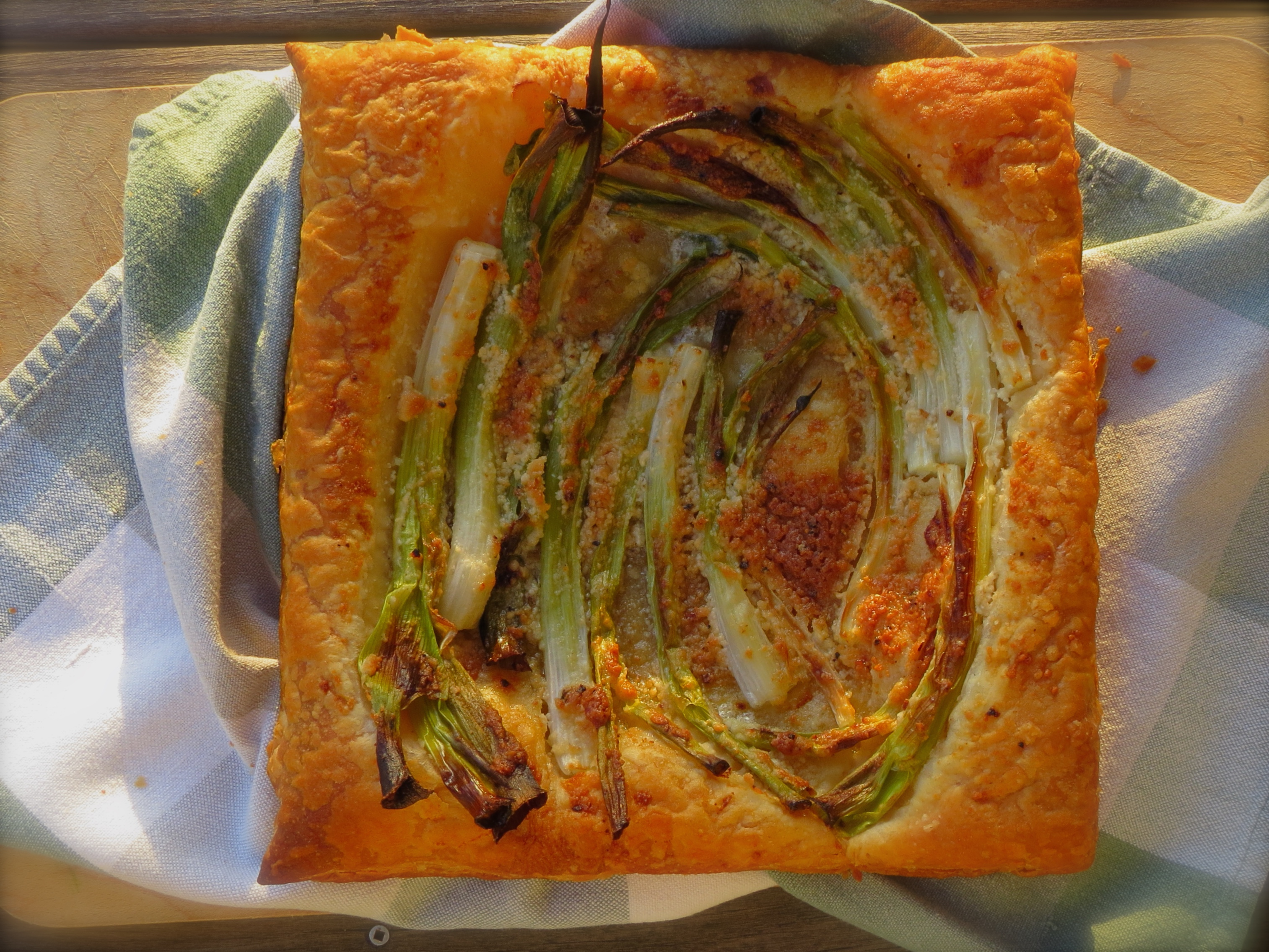 Green Onion Galette, a quick supper of puff pastry, onions and Parmesan cheese.