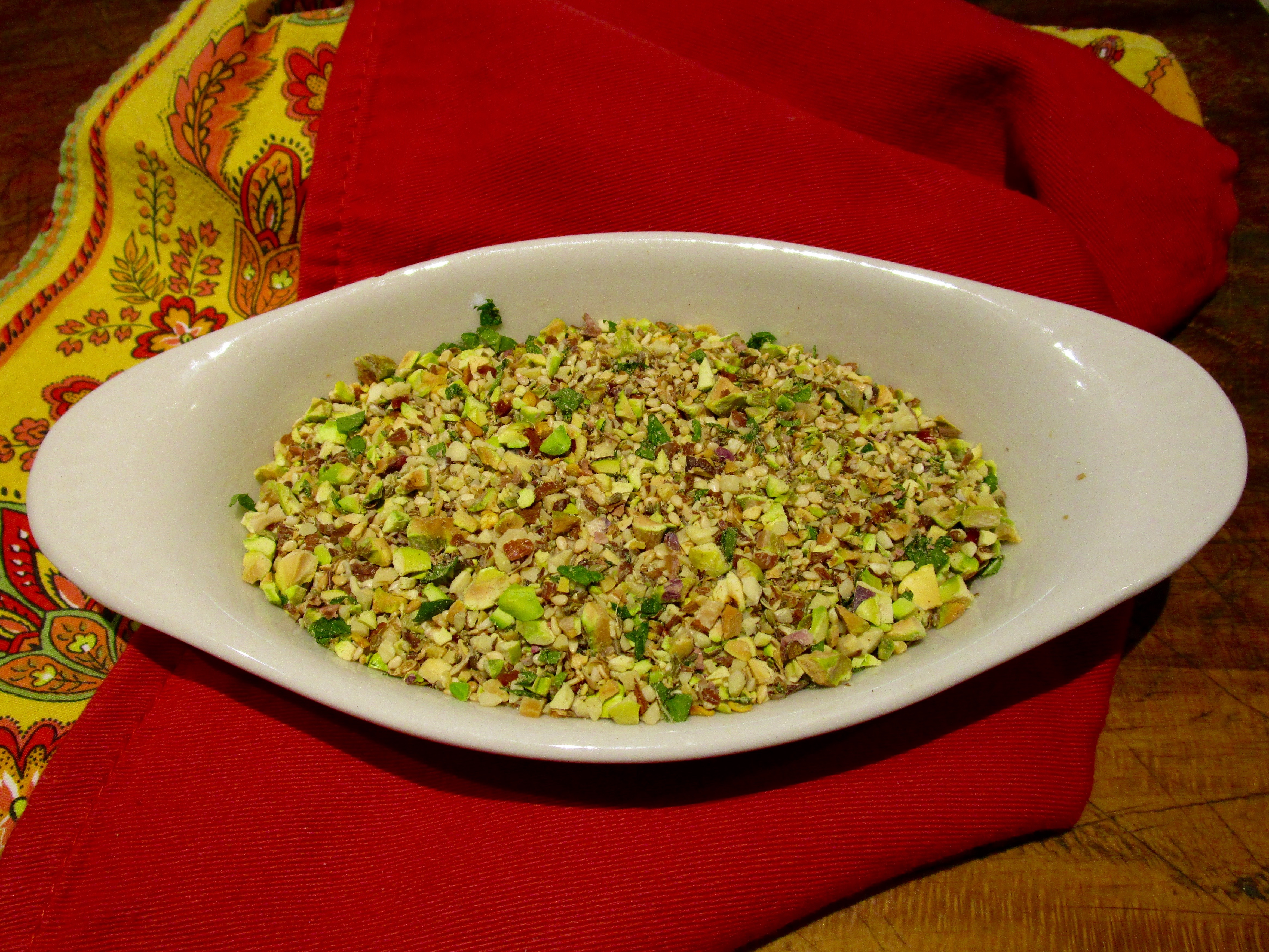 Pistachio Dukka, a traditional Egyptian combination of nuts, seeds and spices, is served with rustic bread and olive oil.