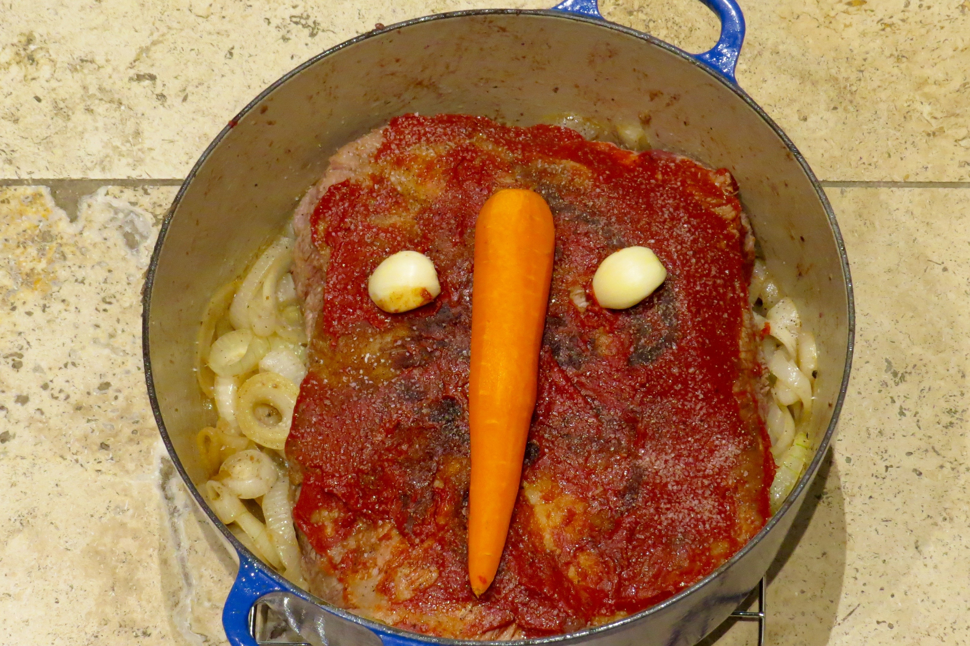 The beef brisket is ready for the oven, to cook, and cook, and cook some more.