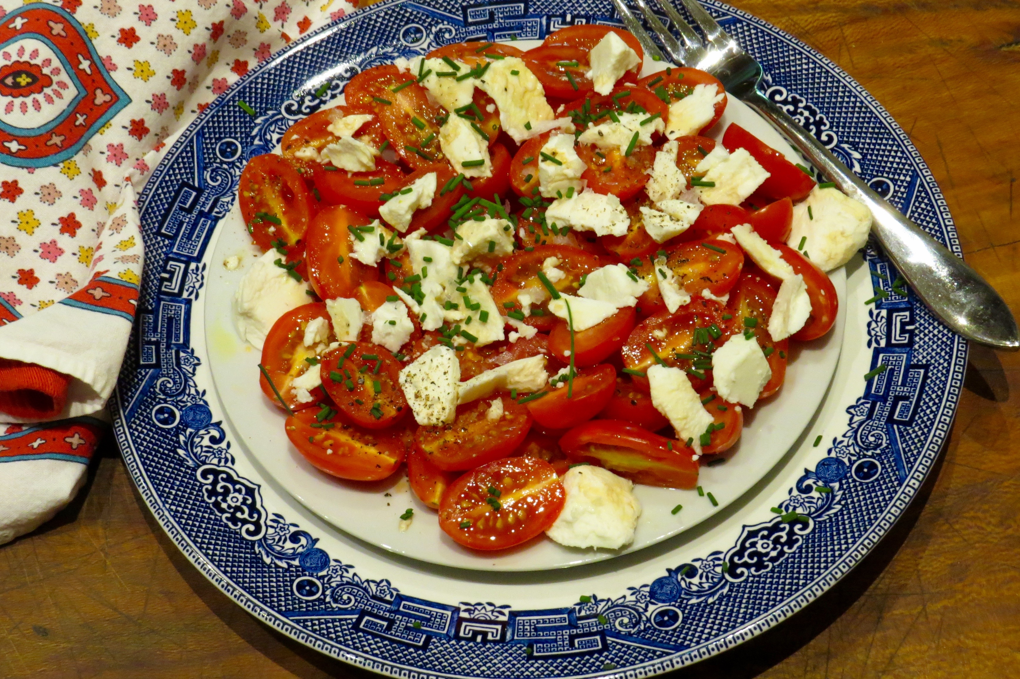 Tomatoes with Herbs and Goat Cheese, a quick and easy salad to be served with cherry, grape, or various heritage tomatoes.