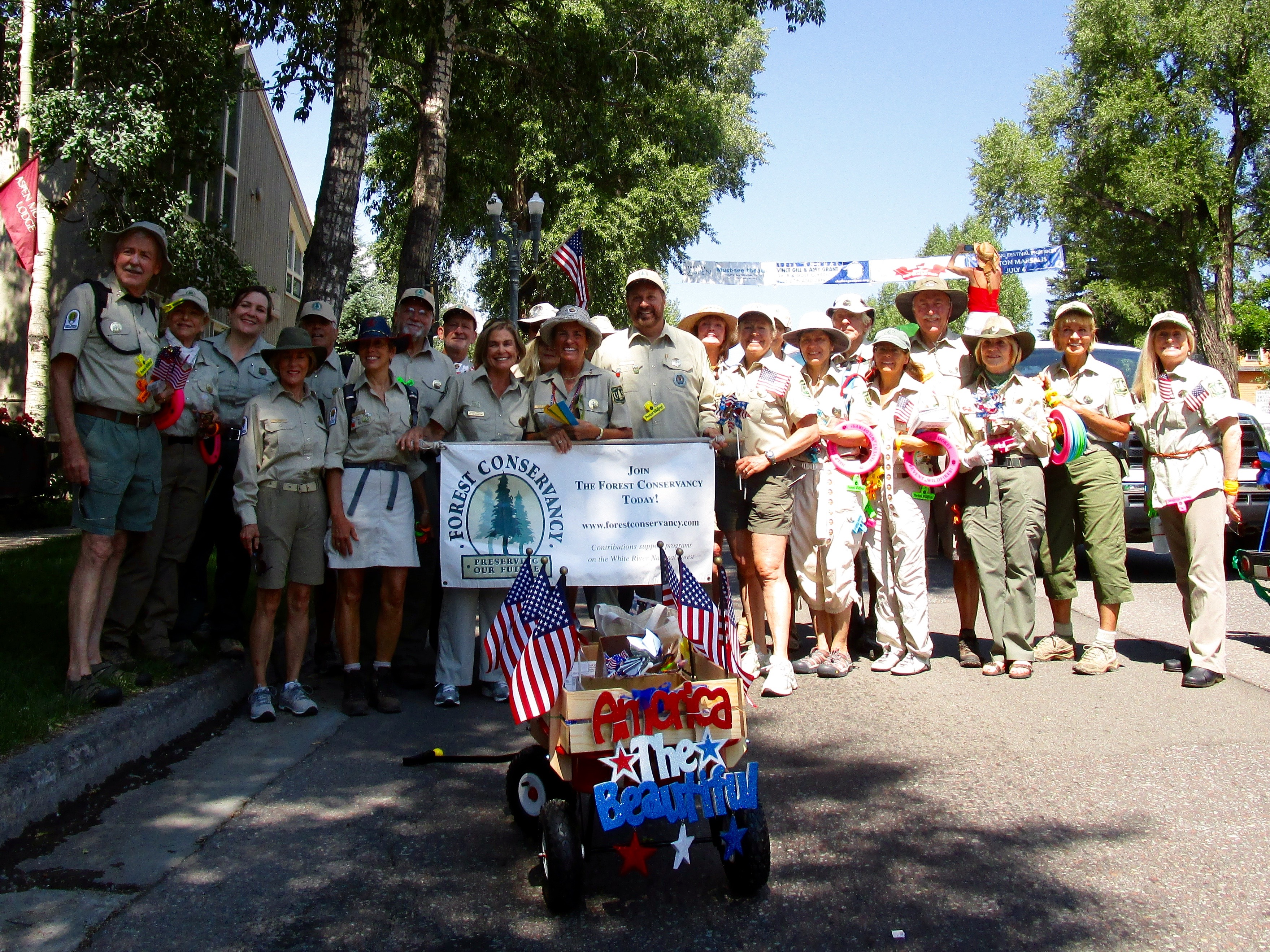 We volunteer USFS Rangers are ready to Go. We're just about to set off and escort Smokey (he gets to ride on the truck) in Aspen's 4th of July Parade.  Lots of swag to share with the kids who all want to meet the big guy.