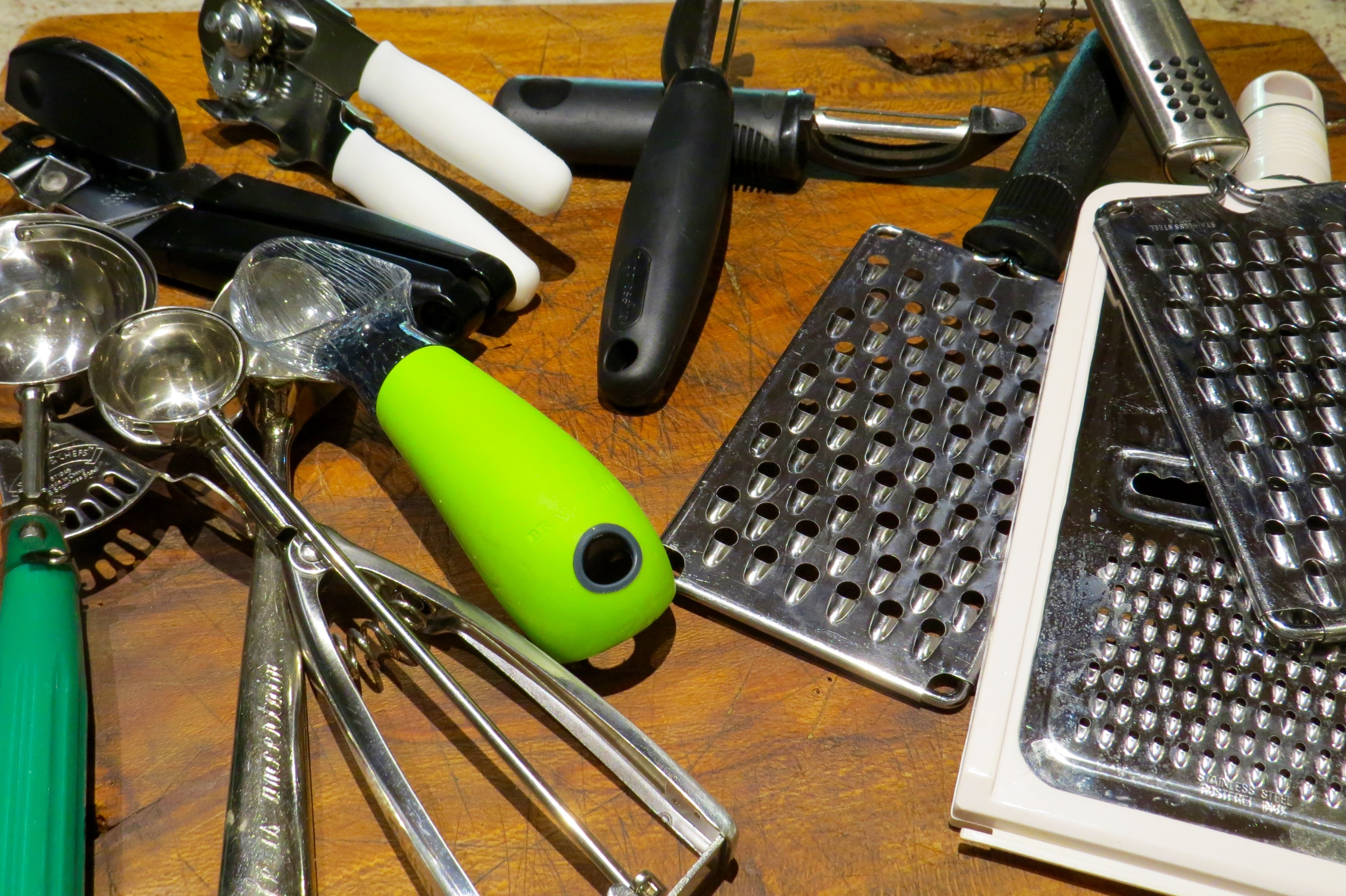 ANOTHER KITCHEN PURGE. WHO NEEDS 4 ICE CREAM SCOOPS, THREE CHEESE GRATERS, 2 CAN OPENERS OR 2 VEGGIE PEELERS?
