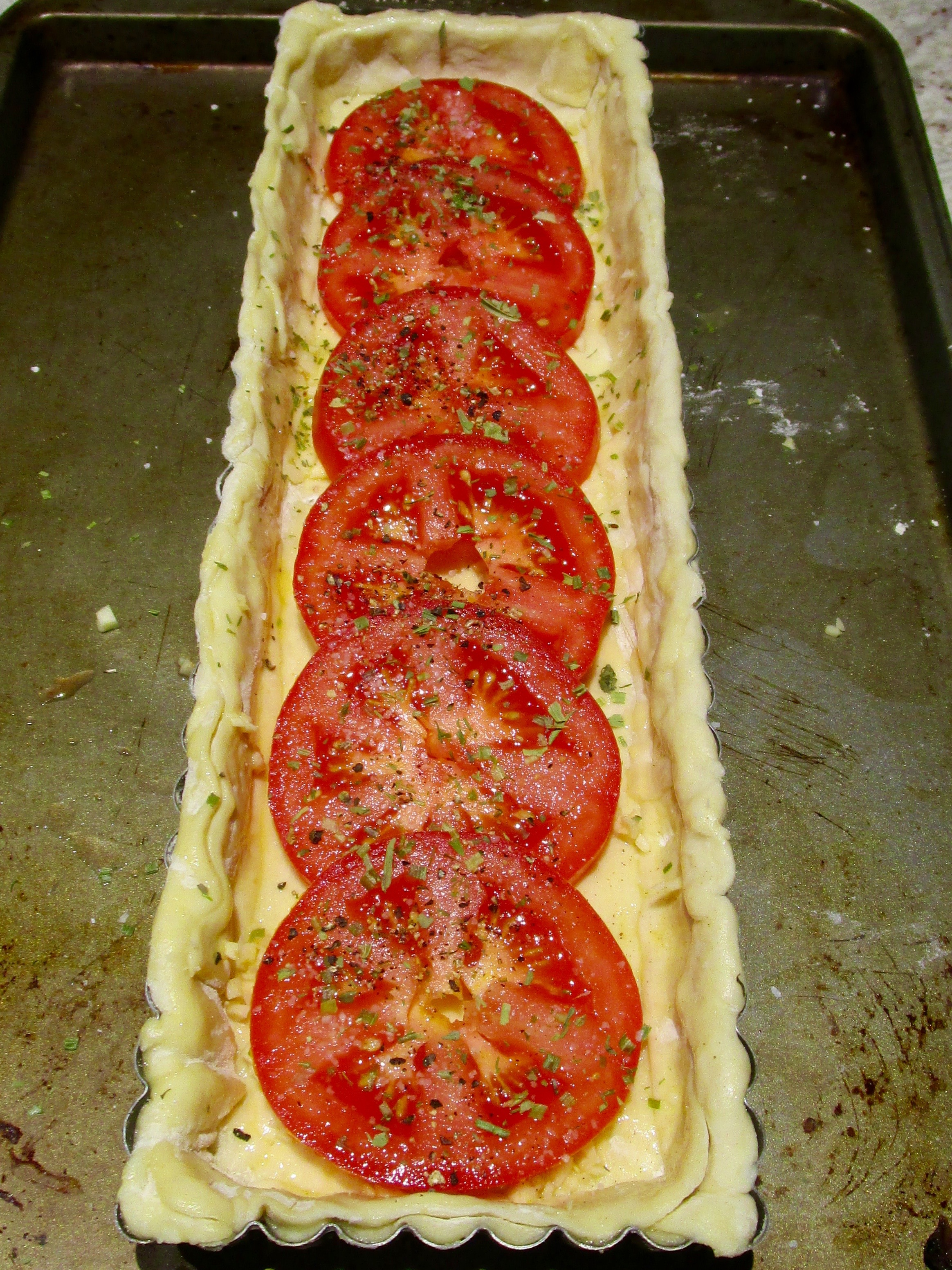 TO CARAMELIZE AND SOFTEN THE TOMATOES, THEY BAKE ALONE FOR 15 MINUTES AT 375 DEGREES BEFORE BEING JOINED BY CHEESE.