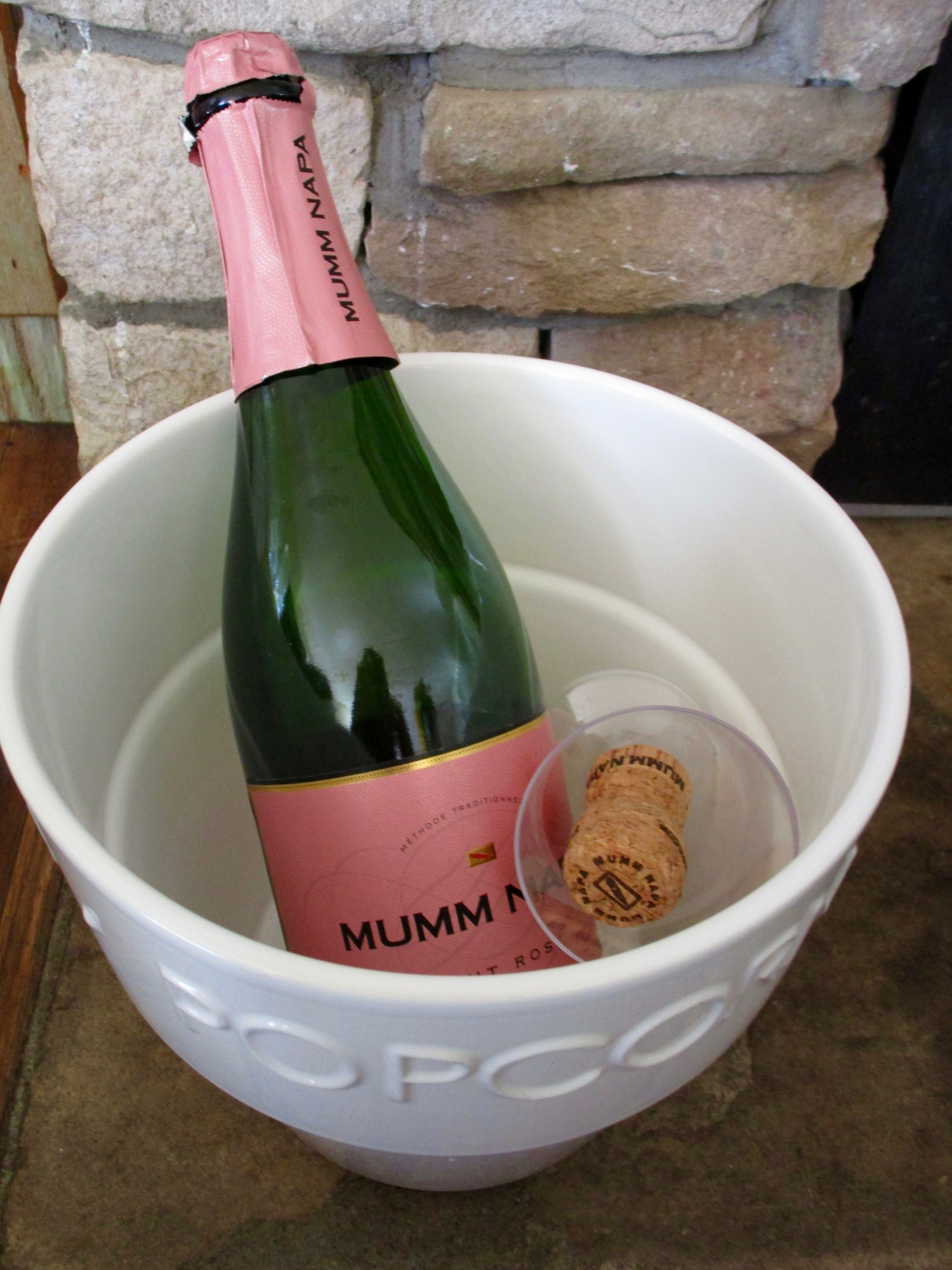 After buying 3 bags of ice, I was able to keep the  champagne very comfy in it's popcorn bowl container.