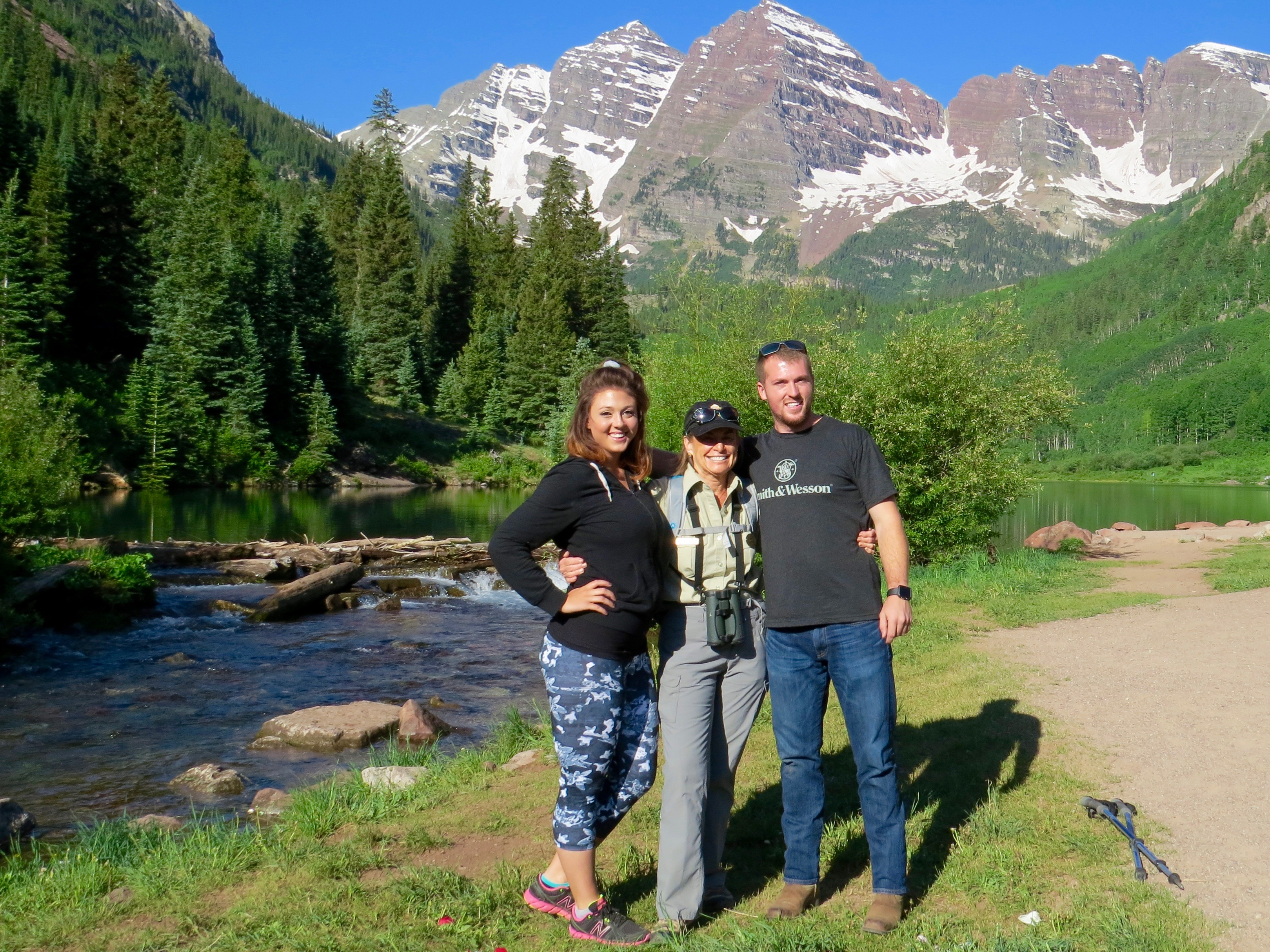 """7:30AM, Maroon Bells - I came upon this young man, a carefully set blanket with champagne on ice nearby, on his knee proposing to his girlfriend. A few  early visitors stood quietly, watching. """"What if she says No,"""" one whispered.  (She didn't.) It was an officially-sanctioned proposal, the happy couple decided."""